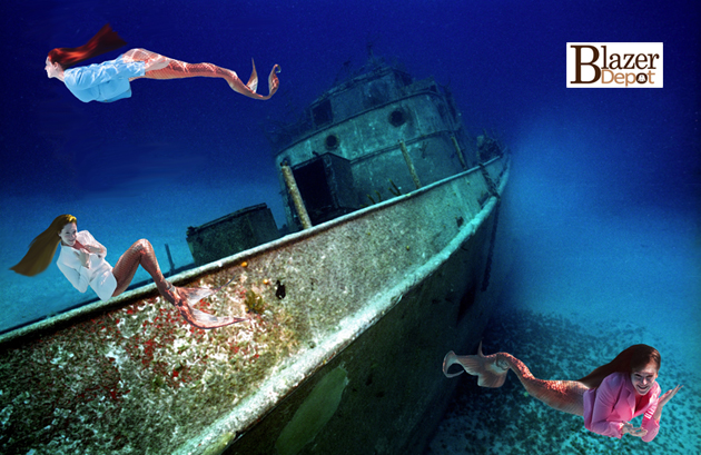 beautiful mermaids swimming around shipwreck by blazer depot